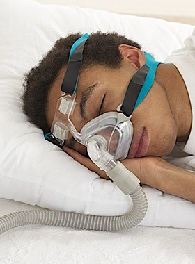 Man sleeping with CPAP mask