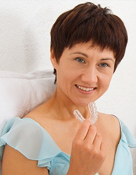 Woman holding a sleep apnea appliance