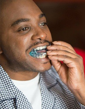 Man using a sleep apnea oral appliance