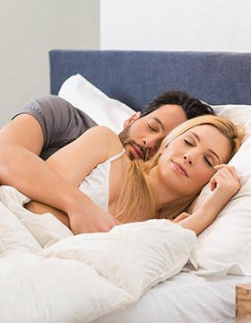 Man and woman sleeping soundly
