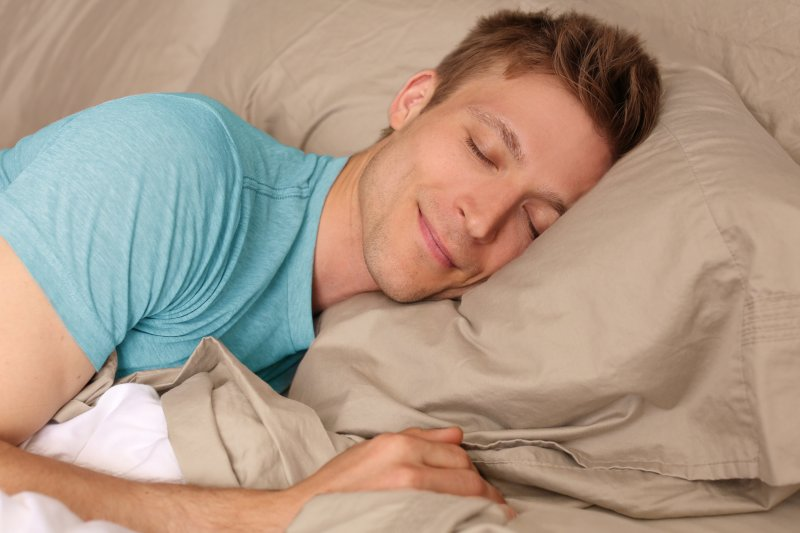 man sleeping peacefully and smiling