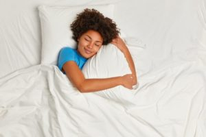 Woman with sleep apnea soundly sleeping in bed
