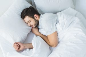 Man sleeping soundly in bed after sleep test
